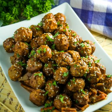 Slow Cooker Asian Barbecue Meatballs with frozen meatballs, vegetables, teriyaki sauce, barbecue sauce and srirachi are just what you need to make these sweet and spicy meatballs.