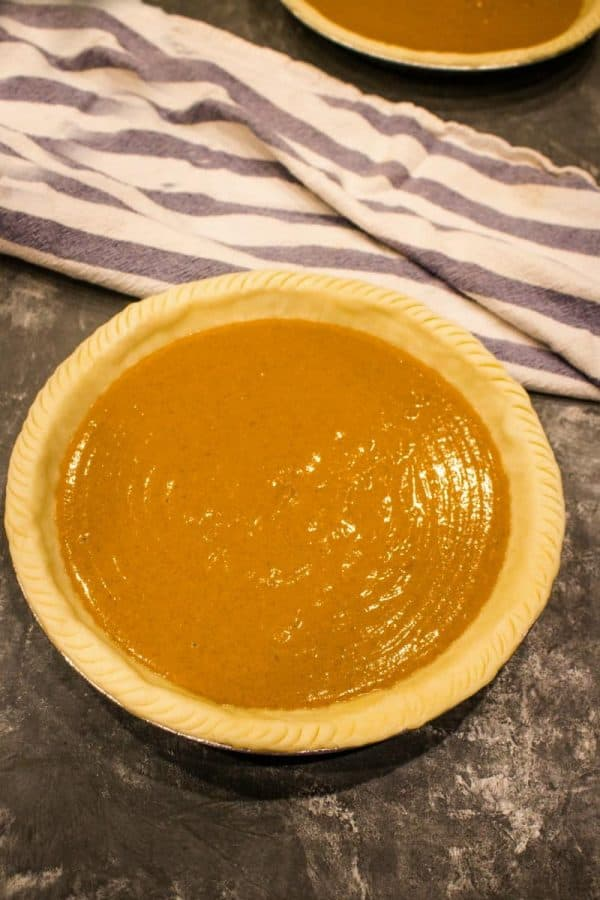 Make ahead pumpkin pie ready for the oven.