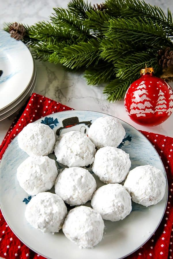 Chocolate Chip Snowball Cookies - filled with melting chocolate chips and festive sprinkles, these sugar dusted cookies are a favorite holiday cookie recipe.