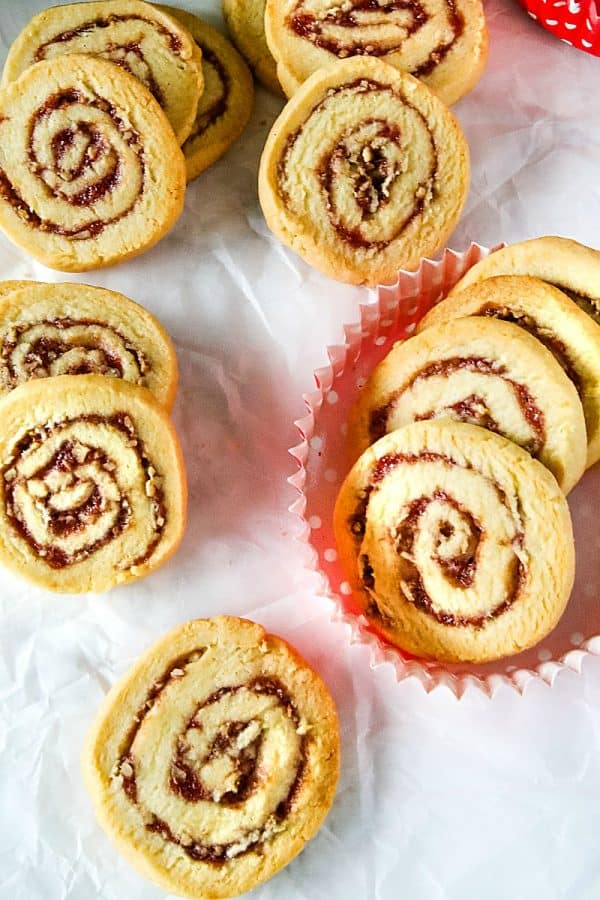 Raspberry Pecan Swirl Cookies are easy recipe sugar cookies swirled with raspberry jam and pecans. Perfect for holidays and  gift giving!