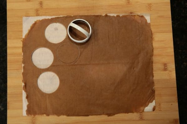 Thin gingerbread dough cut into round crisps.