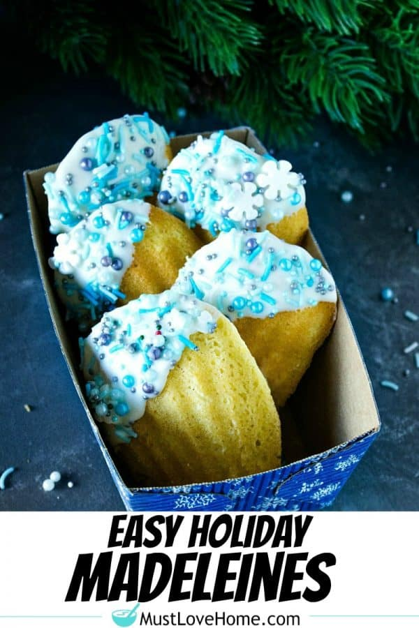 Easy Holiday Madeleines - French butter cookie cakes that are golden crisp on the outside and soft and spongy in the middle. These teacakes, dipped in white chocolate and decorated for the holidays, are surprisingly easy to make with the most basic ingredients.