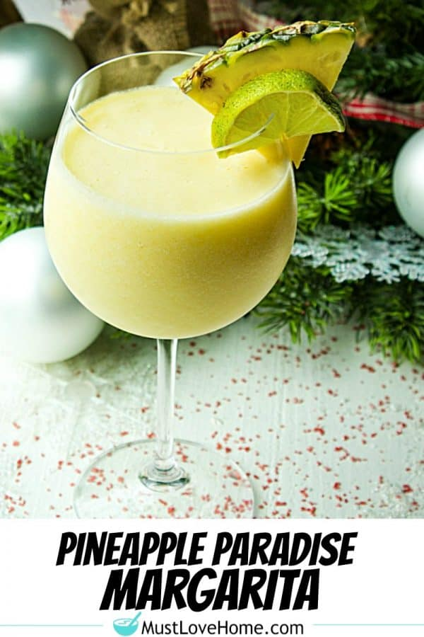 Pineapple Paradise Margarita is a smooth and delicious winter cocktail, guaranteed to evoke thoughts of sun and sand, made with pineapple tequila, coconut milk and frozen chunks of pineapple!