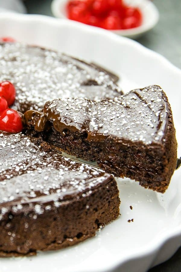 This decadent, gluten-free  Flourless Chocolate Cake with Dried Cherries is for serious chocolate lovers. With only 8 ingredients, including bittersweet chocolate and cocoa powder, it's irresistibly delicious.#mustlovehomecooking