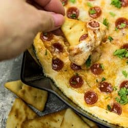 Pepperoni Pizza dip recipeis creamy, cheesy, loaded with spicy pepperoni and totally crave worthy! Serve your pizza dip with pita chips for the ultimate party snack. #mustlovehomecooking