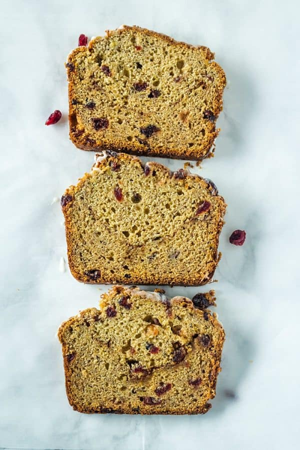 Cranberry Cinnamon Banana Bread - super moist and tender bread with cranberry, cinnamon and yogurt flavors make this delicious loaf perfect for breakfast or dessert!