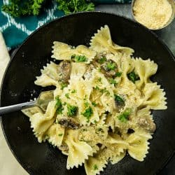 Creamy Mushroom Farfalle Pasta is a simple, easy to make meatless Italian dinner of mushrooms, scallions and seasonings tossed with noodles in a creamy parmesan sauce. #mustlovehomecooking