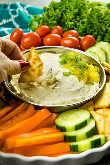 This fun and insanely addictive party pickle dip is made with cream cheese, dill pickles and seasoning and takes only minutes to make.