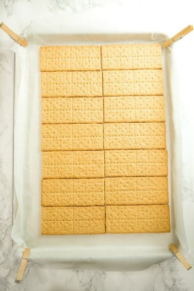 Graham crackers lines up on parchment paper