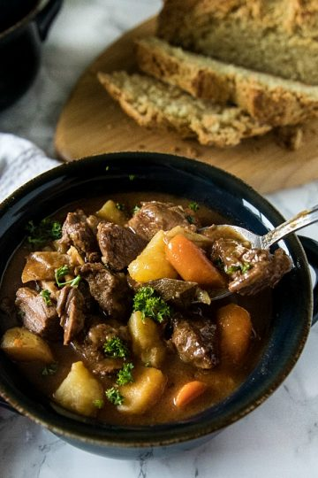 Easy Guinness Beef Stew is a hearty meal, with chunks of beef, potatoes and carrots that are slow simmered in a bottle of Guinness Stout. This makes a rich and cozy stew with a gravy that's irresistibly tasty. #mustlovehomecooking #guinnessbeefstew #stpatricksdayrecipes
