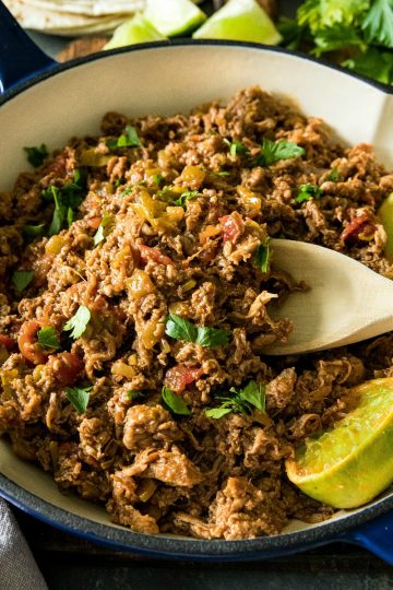 Easy Mexican Beef - tender shaved steak with diced tomatoes and green chilies, seasoned with taco seasoning. Ready to serve in 15 minutes and all in one pan! #mustlovehomecooking #mexican beef