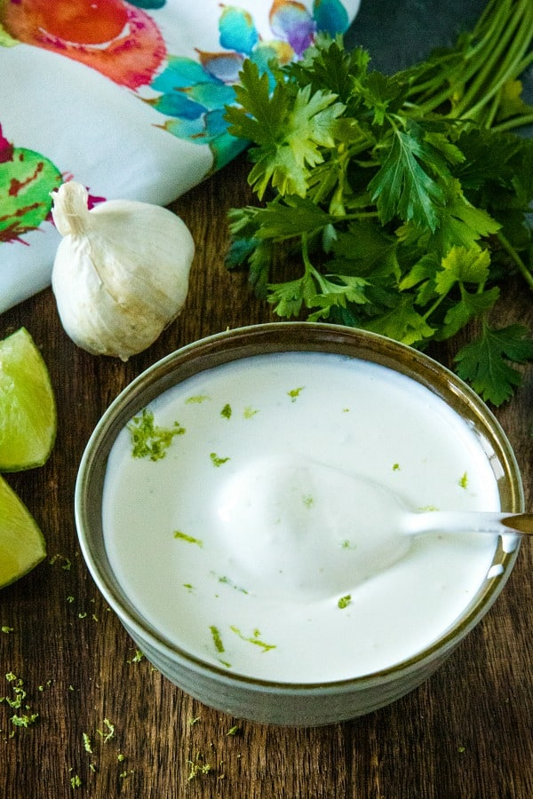 Cool and creamy, this crazy good sour cream and lime sauce adds so much fresh flavor to Southwest dishes with only 3 easy ingredients. #mustlovehomecooking #limecream