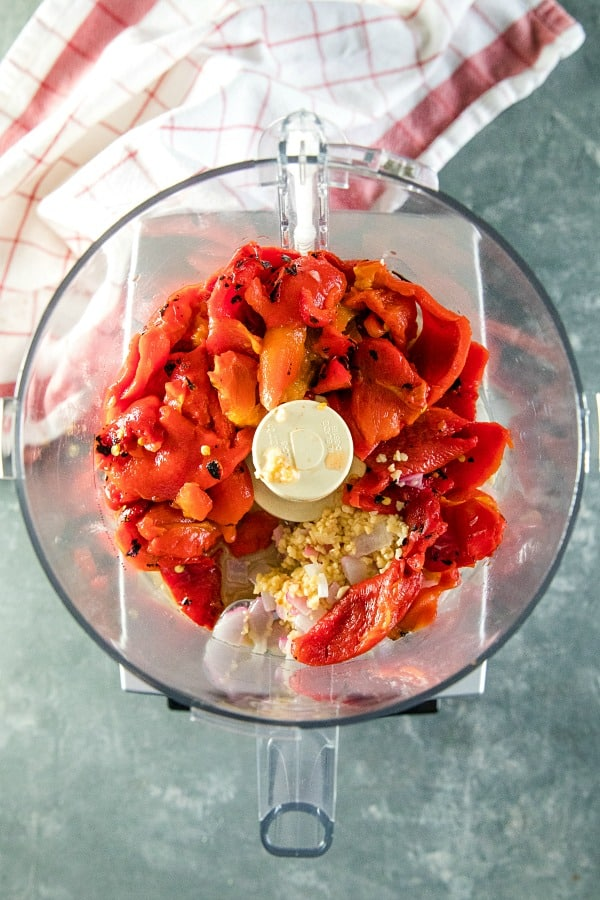 roasted red pepper sauce ingredients in bowl of food processor