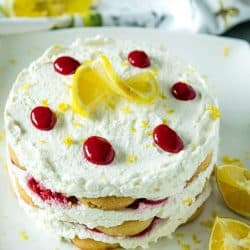 A sweet, fluffy indulgence, this Raspberry lemon Icebox Cake is simple to prep in minutes with whipped cream, raspberries and buttery shortbread cookies. #mustlovehomecooking