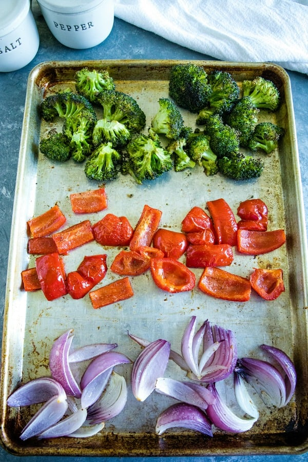 Broccoli, peppers and onions on sheet pan ready for roasting