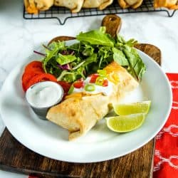 Easy Oven Chicken Chimichangas with seasoned rice, salsa and cheese are a healthy, lighter twist on the Mexican classic. #mustlovehomecooking