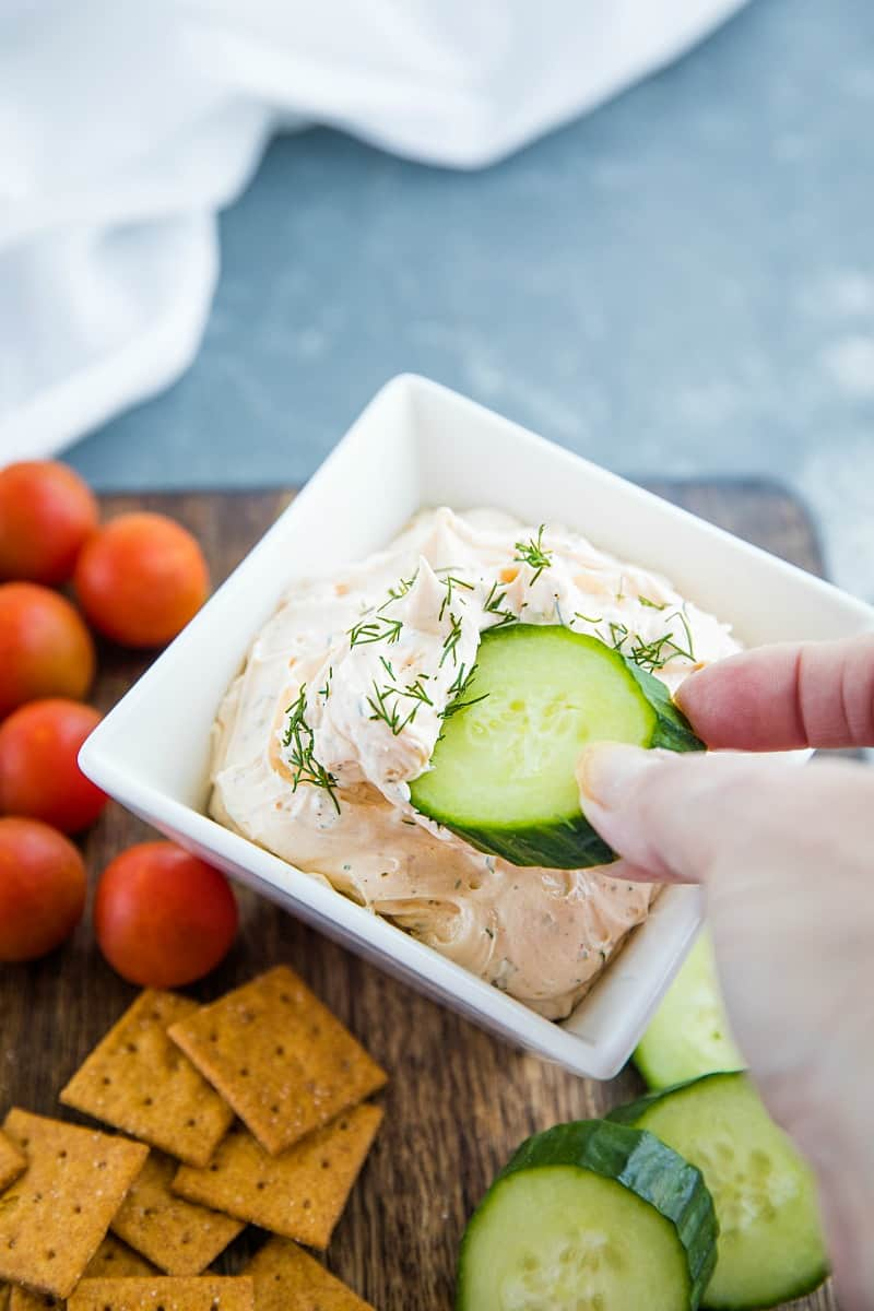Zesty Dill Ranch Dip is a savory, light dip made with cream cheese and sour cream blended with fresh herbs and ranch seasoning. #mustlovehomecooking
