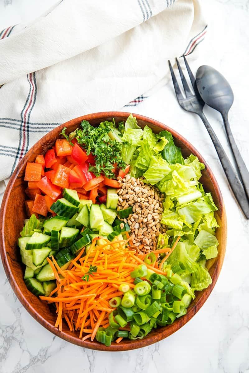 Large wooden bowl with chop salad ingredients