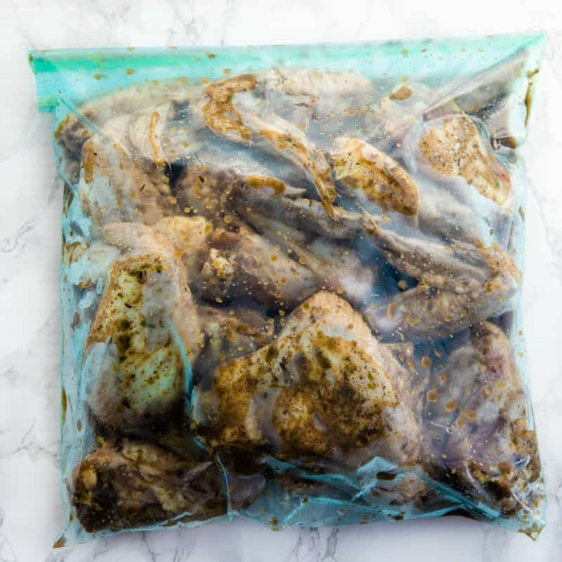 Chicken wings marinating in a plastic bag.