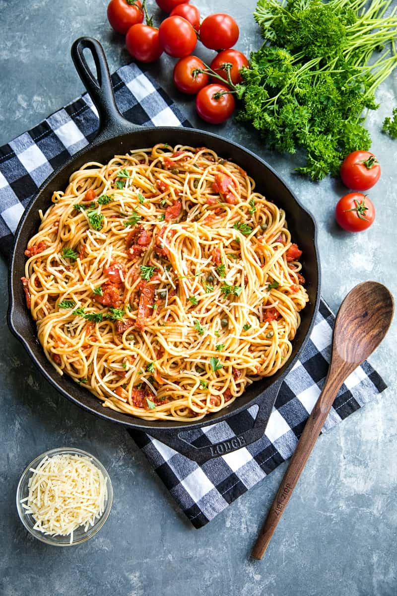 Sun Dried Tomato Puttanesca with tomatoes, anchovies and capers is super fragrant and bursting with flavor...an Italian original made with simple pantry ingredients. #mustlovehomecooking
