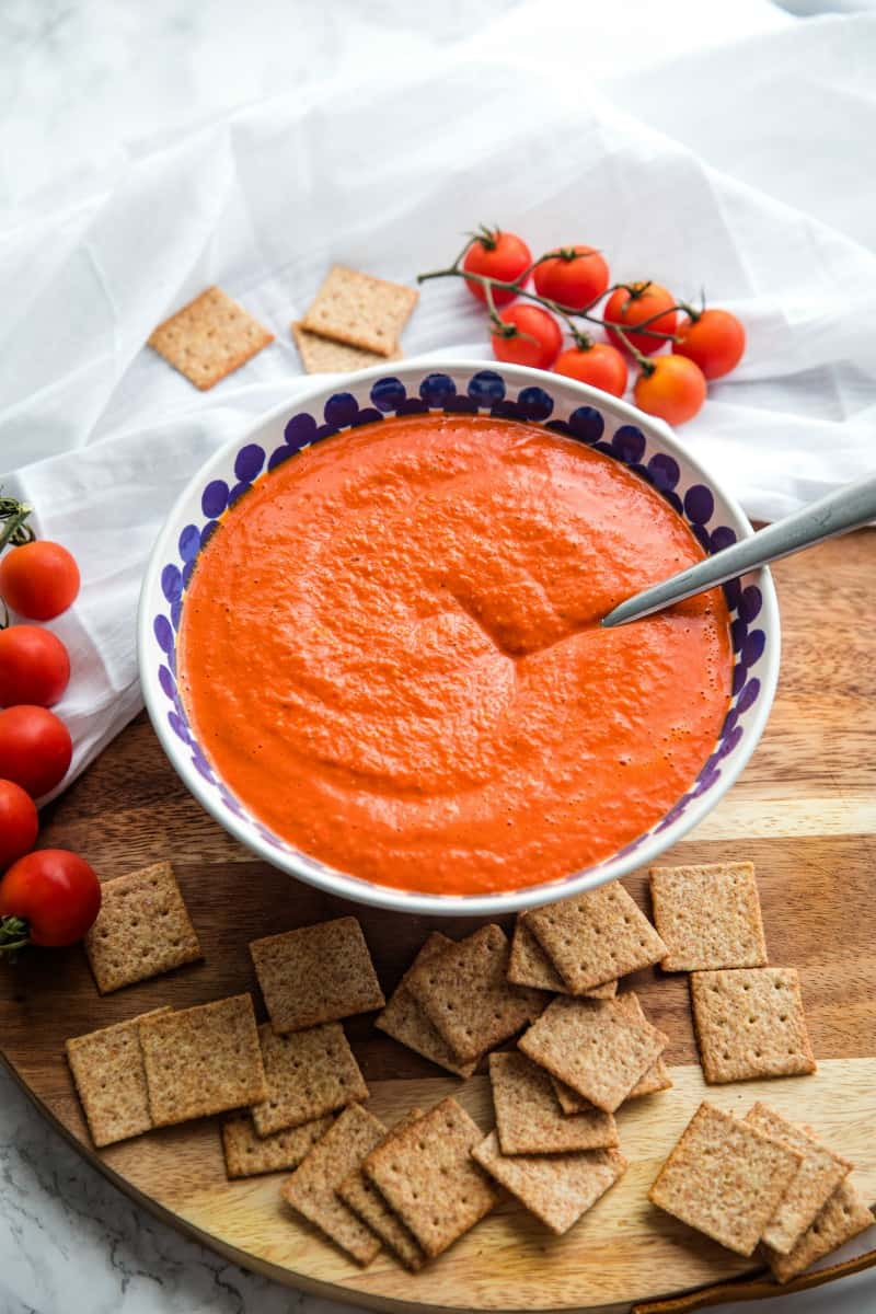 Easy Smooth Romesco Sauce with roasted red peppers. tomato, almonds and garlic. A bold snappy sauce perfect for pasta, chicken, eggs and more.