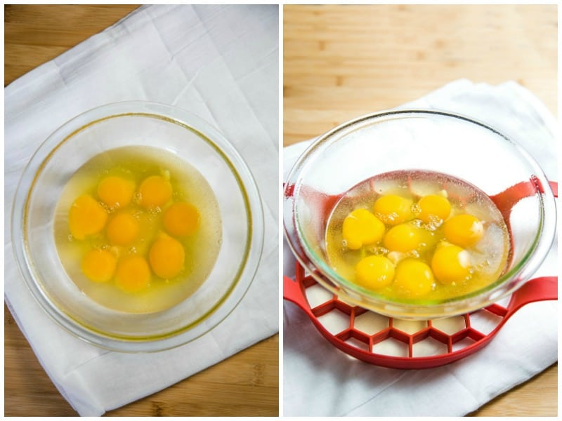 cracked in eggs in a glass mixing bowl with a silicone sleeve