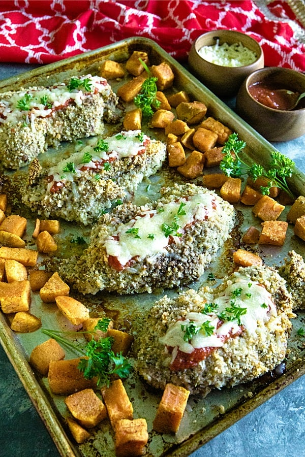 Sheet Pan Pork Chop Parmesan is an easy and complete sheet pan dinner of juicy, bread crumb and parmesan cheese crusted pork chops  with sweet potatoes baked right alongside. #mustlovehomecooking