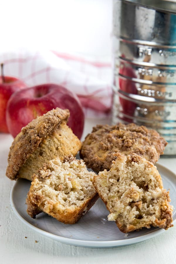 The BEST cinnamon spice apple muffins are filled with fresh apples, and piled high with a crisp, buttery crumb layer.