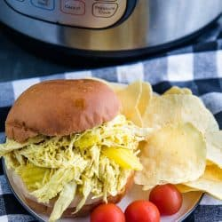 Tangy and flavorful shredded chicken, made with banana peppers and ranch seasoning, ready in minutes from your pressure cooker. #mustlovehomecooking