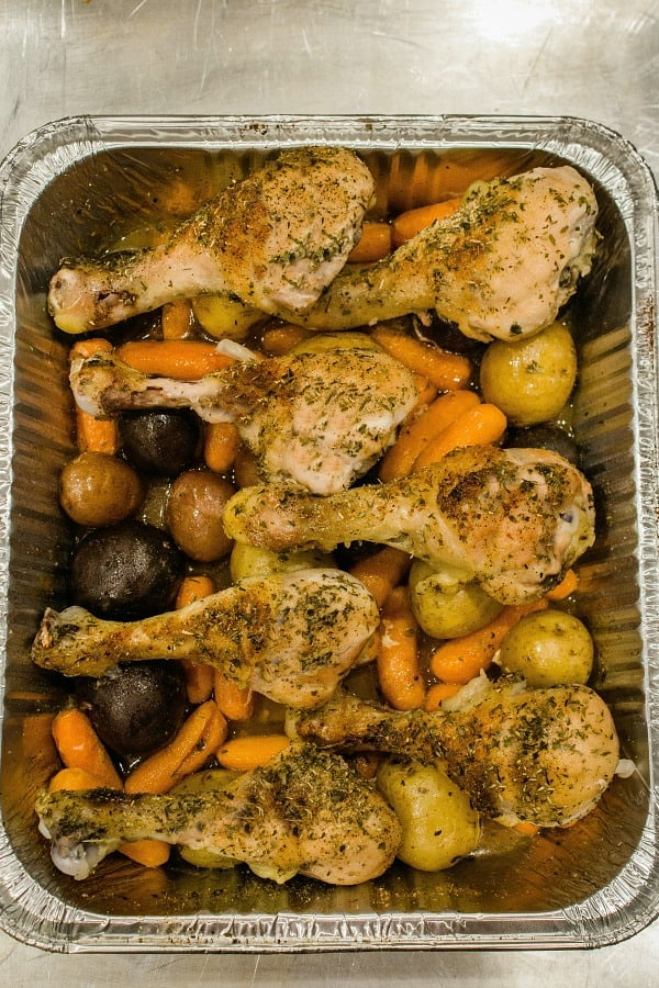 Baked up  juicy and full of garden herb flavor,  this freezer meal with chicken drumsticks, potatoes, carrots and savory sauce is a tasty family favorite.