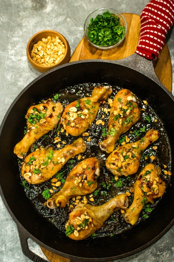 Oven crisp chicken legs and peanuts made into an easy freezer meal with a tasty salty, sweet, and spicy Kung Pao marinade. #mustlovehomecooking