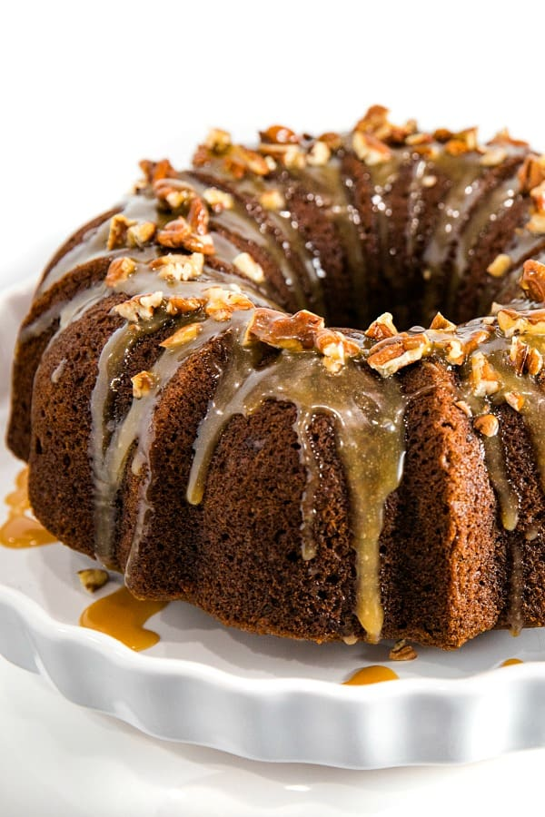 This Pumpkin Bundt Cake is irresistibly spiced, super moist and loaded with toasted pecans. An addictive fall treat you'll crave all year round!