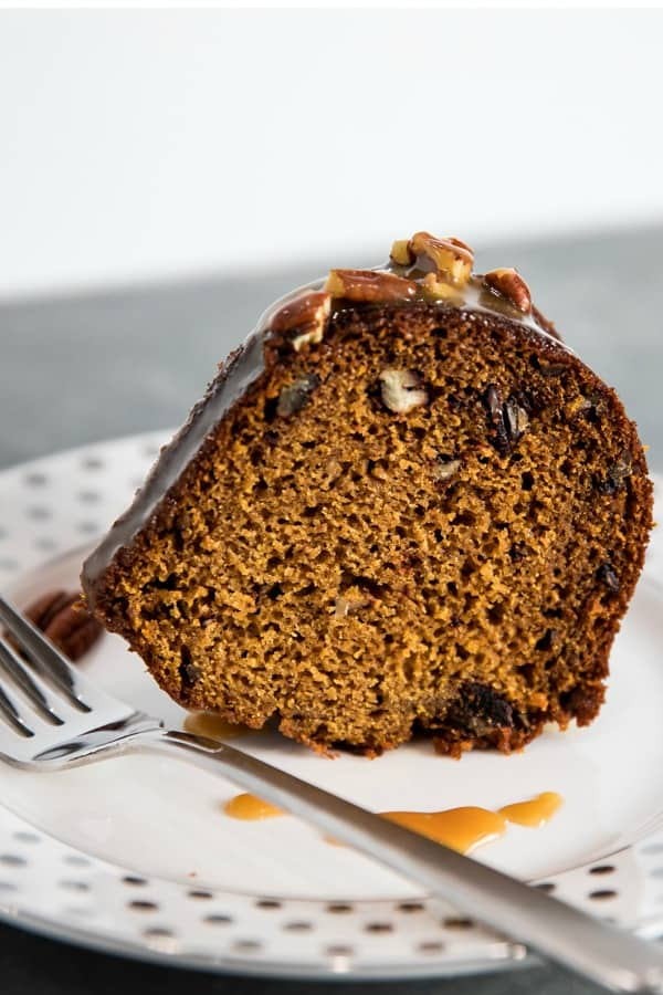 This Pumpkin Bundt Cake is irresistibly spiced, super moist and loaded with toasted pecans. An addictive fall treat you'll crave all year round! #mustlovehomecooking