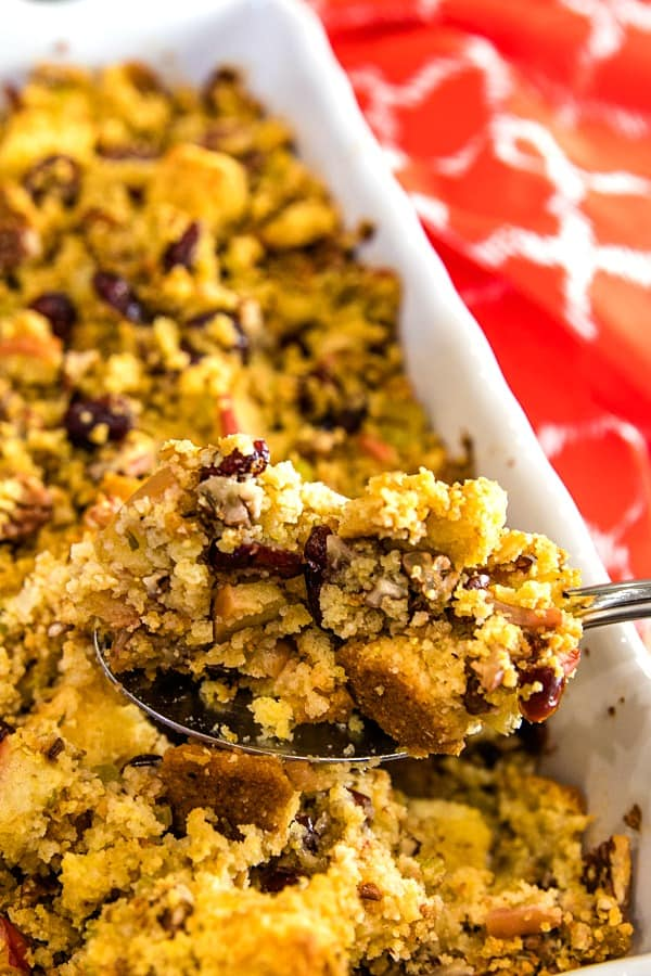 Pecan Apple Cornbread Stuffing made with toasted cornbread , crisp apples, pecans and cranberries, is a delicious sweet and savory dressing that'll be a hit on your holiday table.