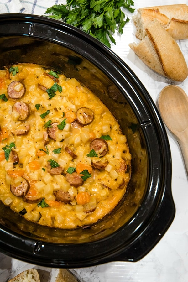 Slow Cooker Smoked Sausage Potatoes is a cozy crockpot meal that's always a dinnertime winner! Easy to make, it's simply comfort food in a bowl.