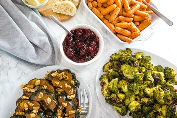 Three sheet pan thanksgiving sides made easy with minimal prep. Roasted Spiced Acorn Squash, Maple Mustard Broccoli and Herbed Carrots all in under one hour! #mustlovehomecooking