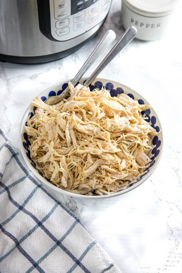 Easy Instant Pot Shredded Chicken is a deliciously easy recipe starter perfect for freezing. Perfect for quick sandwiches, quesadillas, rice dishes, and casseroles!