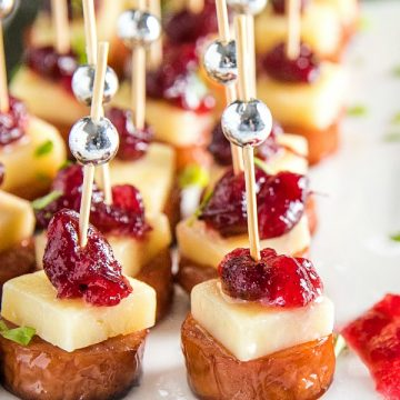 Sheet Pan Smoked Sausage with Cranberry Bites made with cubes of white cheddar and whole cranberry sauce. They're incredibly easy and perfect for holidays or an appetizer for any gathering! #mustlovehomecooking