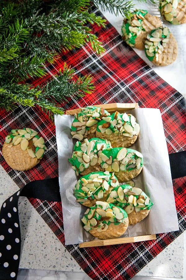 Easy to make Double Almond Butter Cookies - shortbread cookie taste dressed for the holidays with colored chocolate and a sprinkle of almonds! #mustlovehomecooking