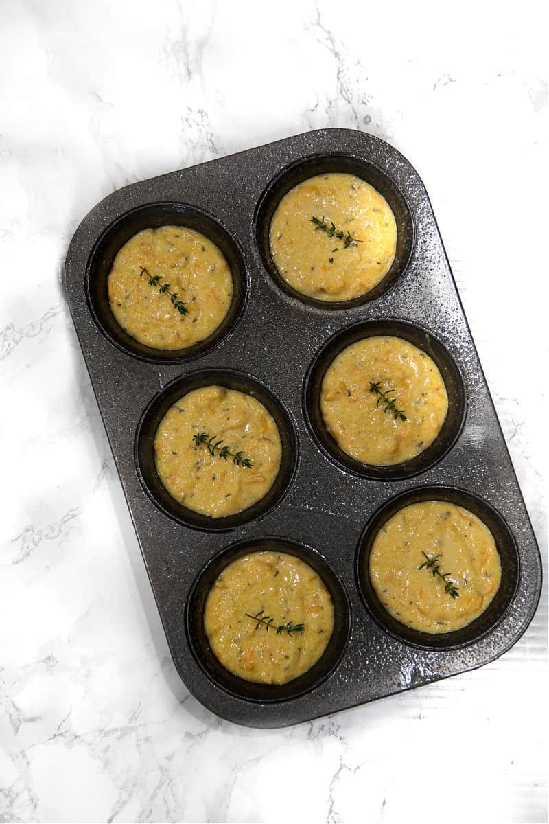 cornbread muffin dough in tin