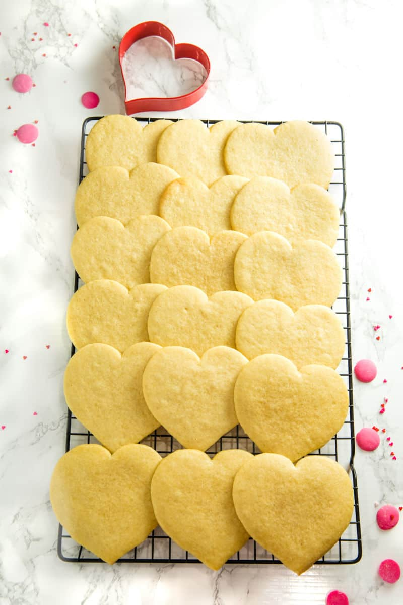 undecorated heart cookies cooling on wire rack