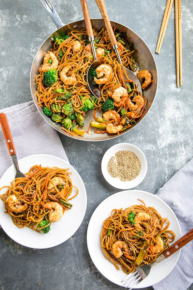 Quick and easy pan fried shrimp and vegetables, tossed with pasta and coated with an addictive spicy sesame sauce.