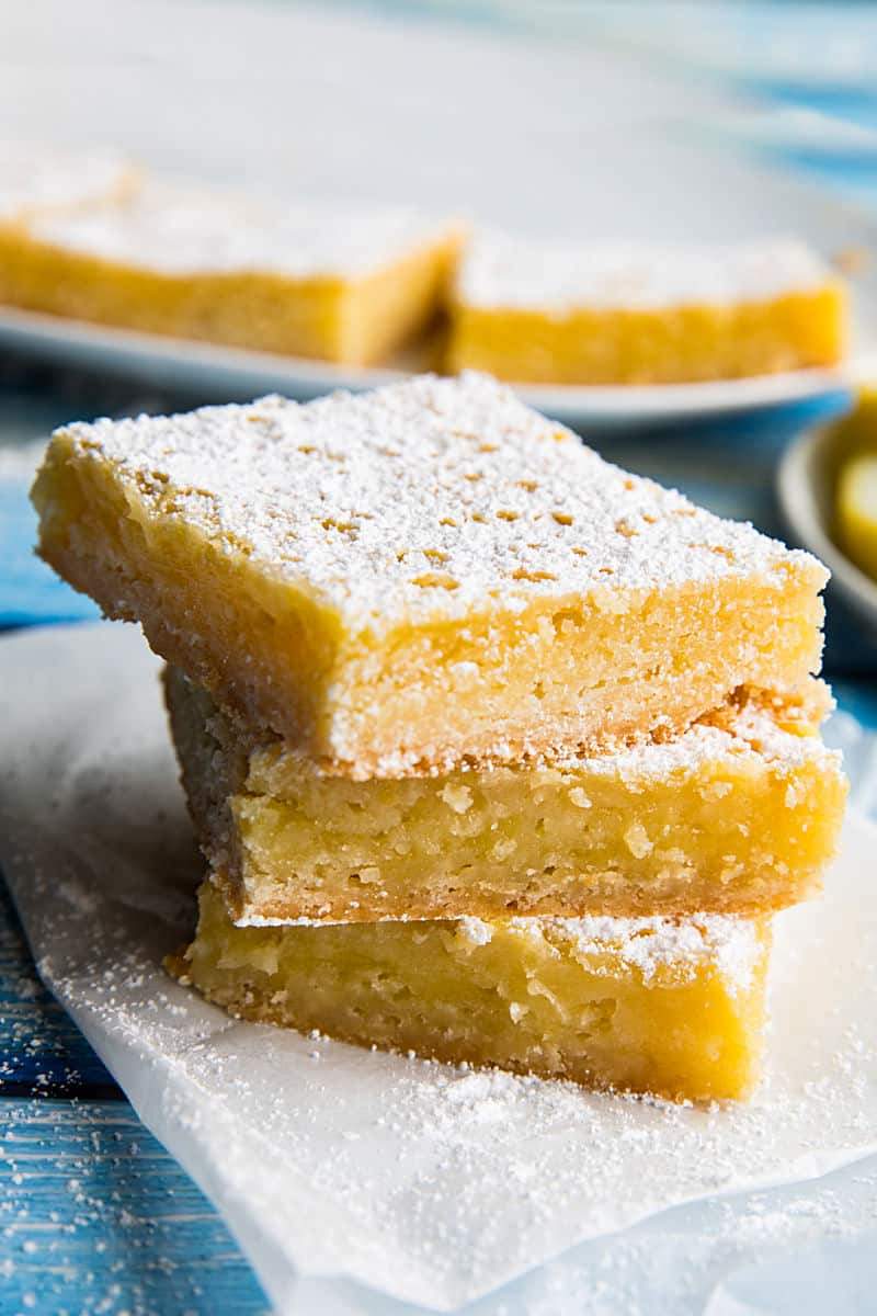 Bright and zippy lemons bars with a buttery shortbread crust and tangy lemon filling. Easy to make and totally delicious! #mustlovehomecooking