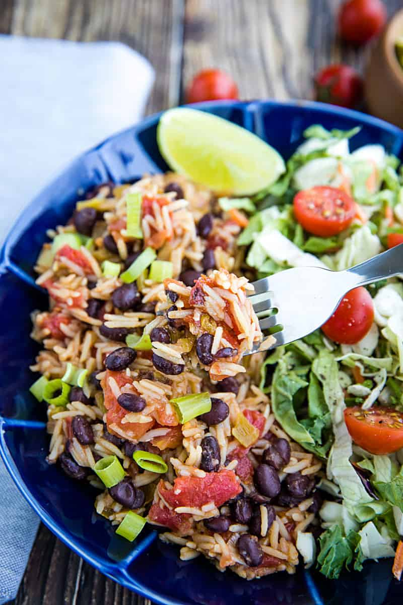 Instant Pot Black Beans and Rice is made quick and easy using a pressure cooker. Mildly spicy with green chilies and garlic, it's made from pantry staples and ready to serve in minutes. #mustlovehomecooking