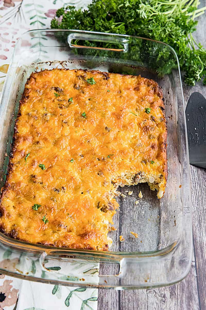 Hominy and Sausage Casserole is an easy, cheesy breakfast or supper bake. This hearty and nutritious comfort food can be made ahead too. #mustlovehomecooking