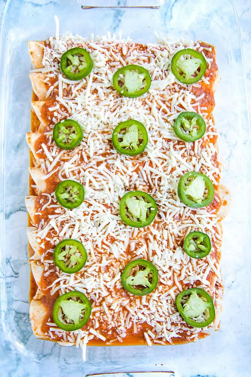 enchiladas ready to bake in glass baking pan