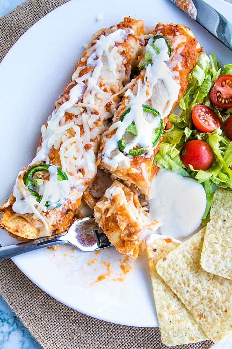 Chipotle Chicken Enchiladas made with shredded chicken, flour tortillas and a droolworthy chipotle enchilada sauce that takes this classic Mexican dish to a whole new level! #mustlovehomecooking