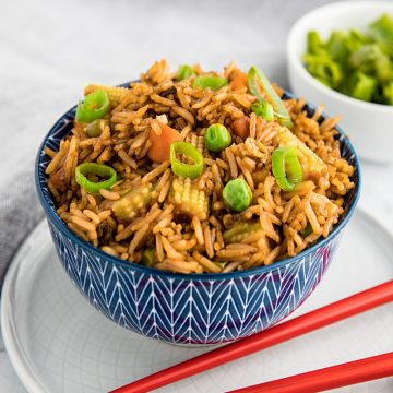 Best Ever Deluxe Fried Rice is a take-away style rice recipe packed with delicious flavor and healthy vegetables that's ready in just minutes! #mustlovehomecooking