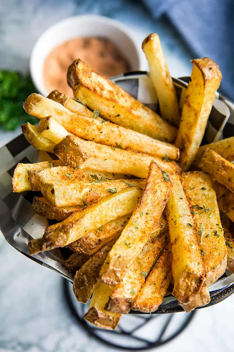 Homemade French Fry Seasoning is quick and simple to make and adds amazing flavor to plain old fries! Sprinkle on fries made in the air fryer, deep fryer and the oven! #mustlovehomecooking