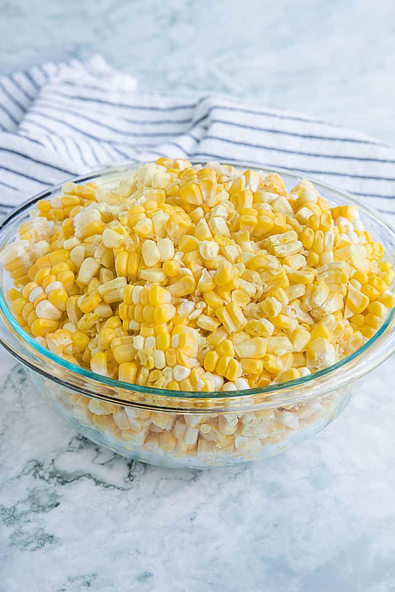 Fresh corn cut from the cob in large glass bowl